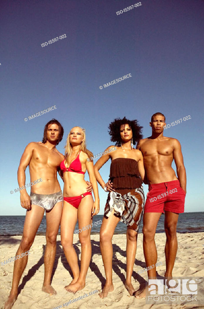 Stock Photo: Young couples on beach.