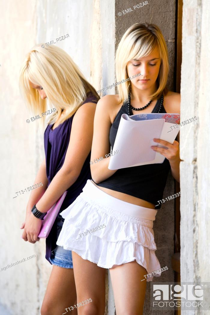 Stock Photo: Two attractive female students.