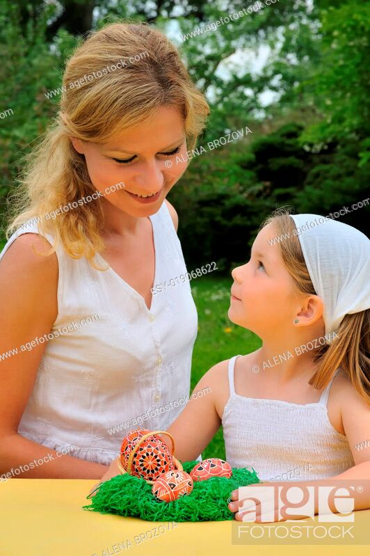 Stock Photo: Young mother and daughter having Easter time.