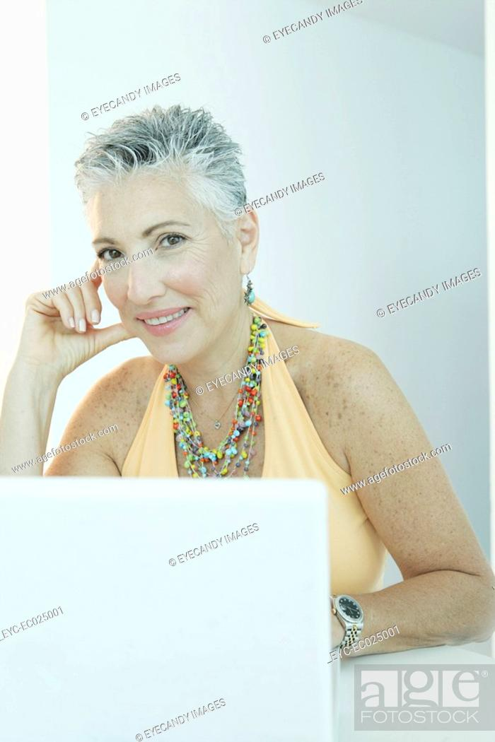 Stock Photo: View of a mature woman with a laptop.