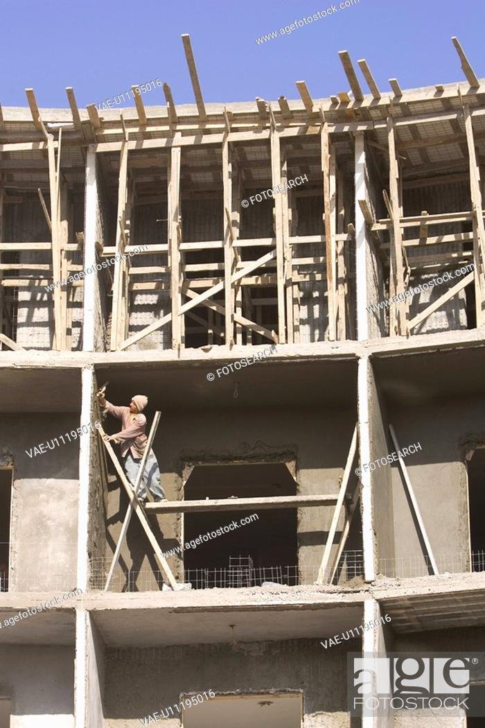 Stock Photo: Building Exterior, Building Structure, Casual Clothing, Clear Sky, Construction Site.