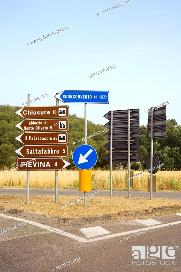 Stock Photo: Road signs pointing different directions, Tuscany.