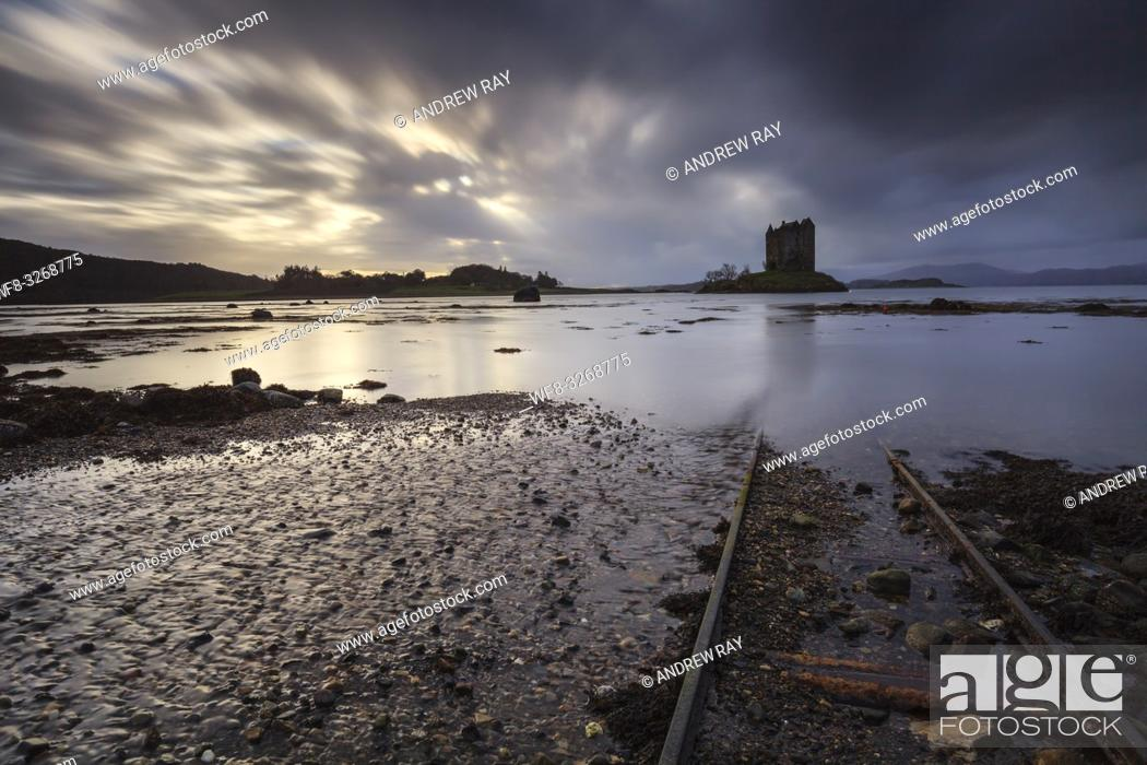 Stock Photo: Rail tracks at Castle Stalker in the Scottish Highlands, captured from a low angle, on an afternoon in early November.