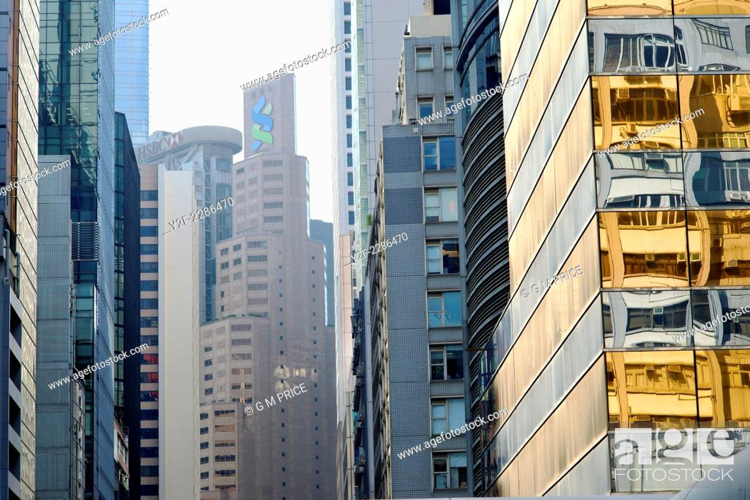 Stock Photo: pattern of commercial building facades in downtown Hong Kong.