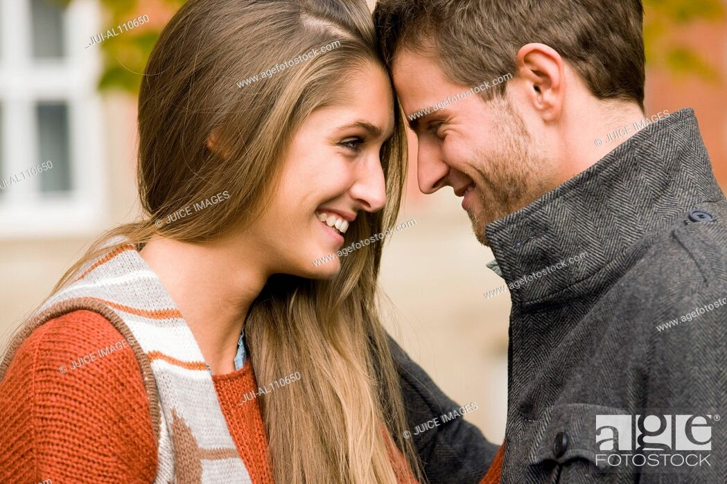 Stock Photo: Young university couple face to face on college campus.