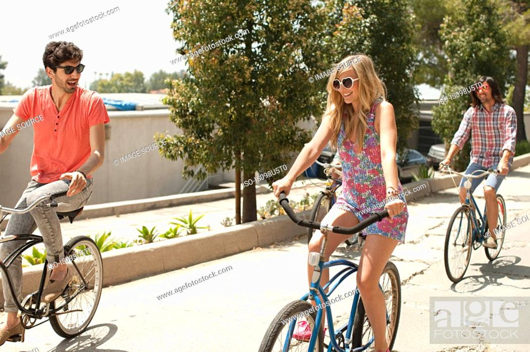 Stock Photo: Young friends on bicycles on vacation.