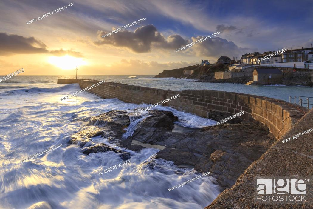 Stock Photo: The pier at Porthleven on Cornwall's Lizard Peninsular, captured in February when sunset coincided with one of the highest tides of the year.