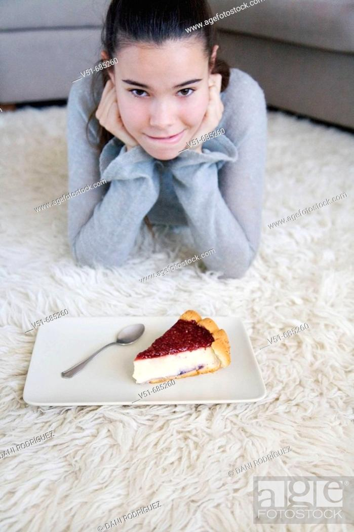 Stock Photo: Teenage girl wanting to eat a cake.