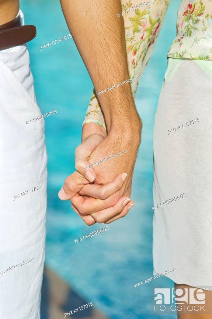 Stock Photo: Couple holding hands.