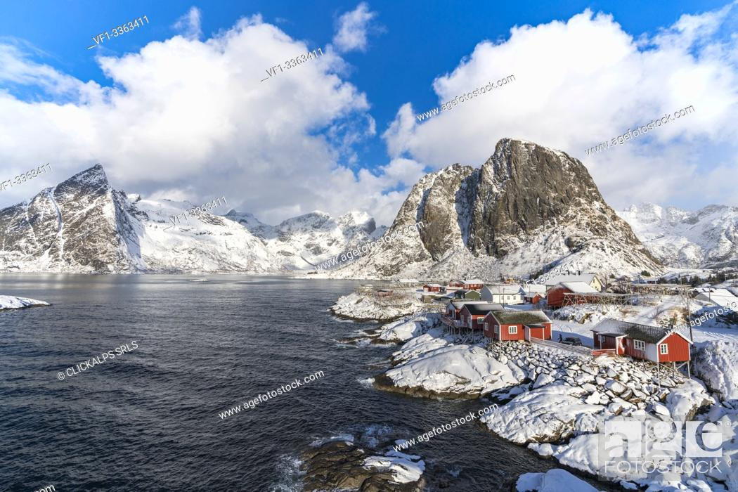 Stock Photo: Hamnoy village covered in snow, with Festheltinden and Olstinden peaks in the background. Moskenes municipality, Nordland county, Northern Norway, Norway.