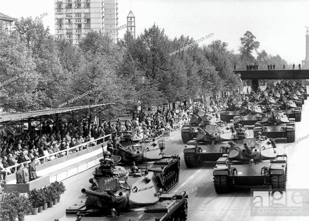 Stock Photo: American tanks driving past a VIP stand during a parade on occasion of the 'Armed Forces Day' on 15th May 1972 in Berlin. - Berlin/Berlin/Germany.