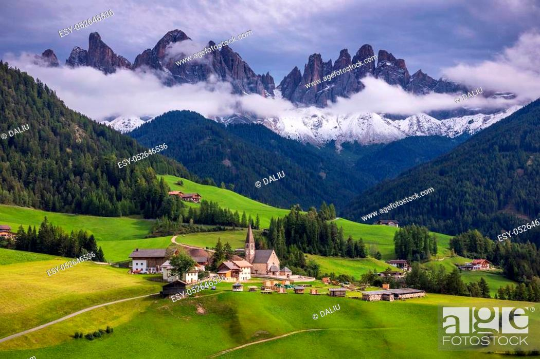 Stock Photo: Famous best alpine place of the world, Santa Maddalena (St Magdalena) village with magical Dolomites mountains in background, Val di Funes valley.
