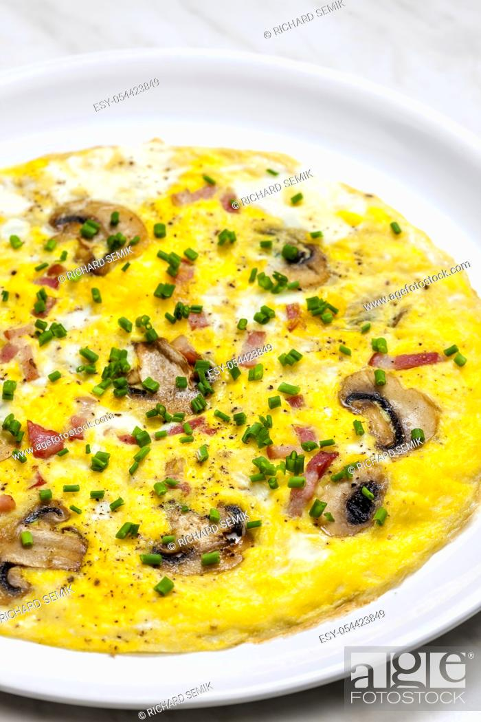 Stock Photo: egg omelette with mushrooms and bacon.
