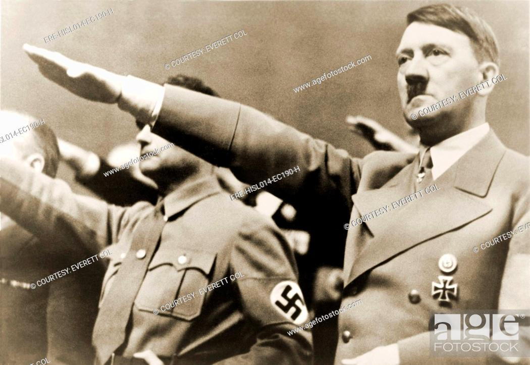 Stock Photo: Adolf Hitler, giving Nazi salute. To Hitler's right is Rudolph Hesse. 1939.