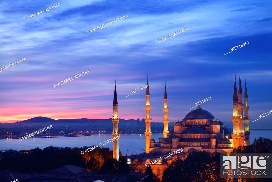 Stock Photo: Lights on the Blue Mosque with red sky in the morning on the Bosphorus Sultanahmet Istanbul Turkey.