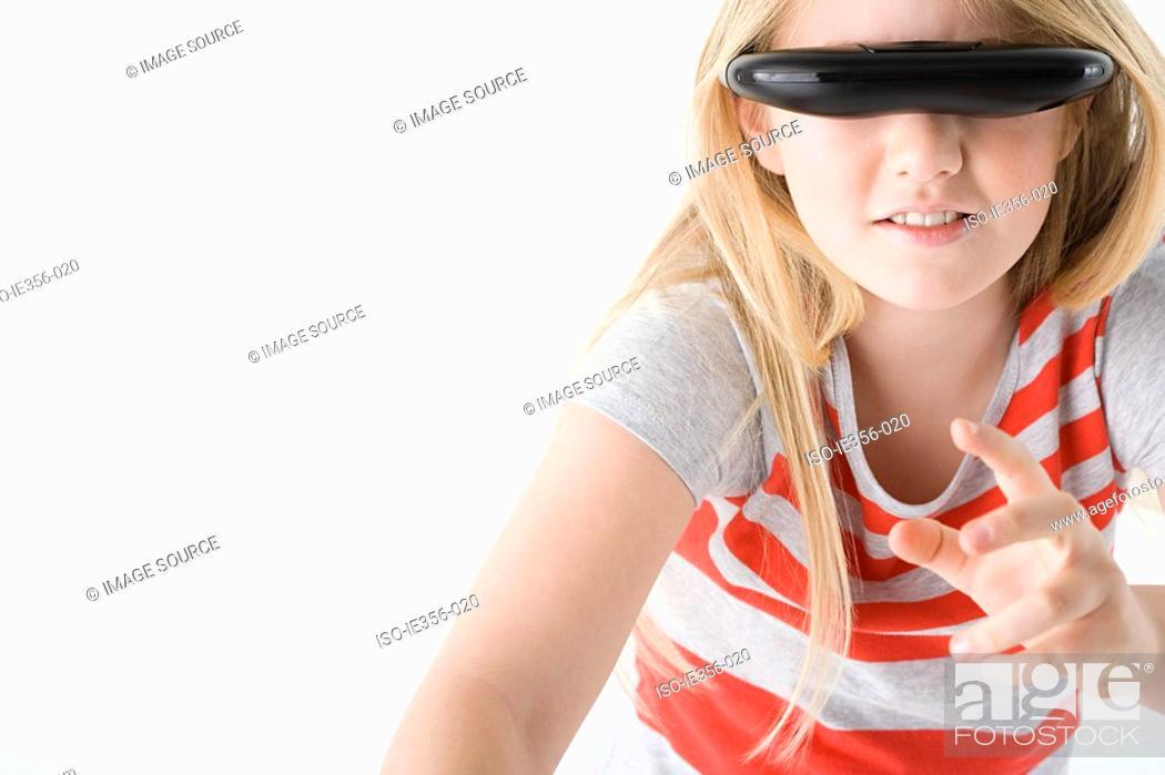 Stock Photo: Girl wearing virtual reality headset.