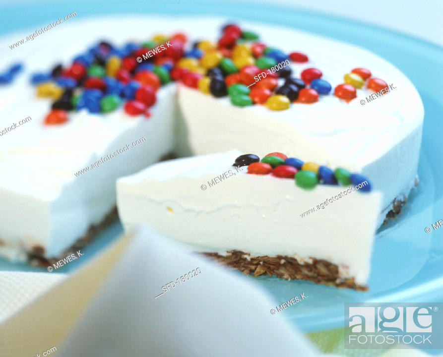Stock Photo: Smartie cake (yoghurt cake with coloured chocolate beans).