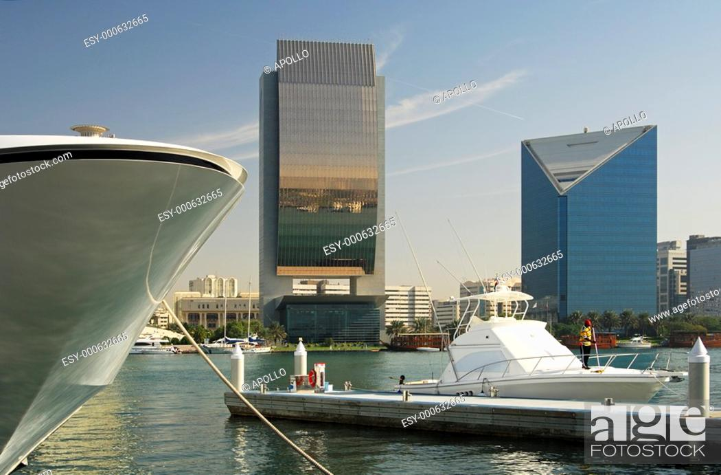 Stock Photo: Yachts and modern architecture on the banks of the Dubai Creek, buildings of the National Bank of Dubai, NBD, and the Dubai Chamber of Commerce and Industry.