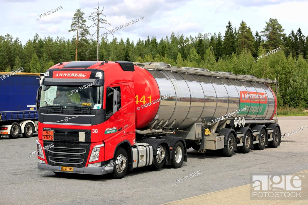 Stock Photo: Orivesi, Finland - August 27, 2018: Red Volvo FH semi tank trailer Anneberg Transport on truck stop. ADR 90-3082 signifies pyraclostrobin. a fungicide.
