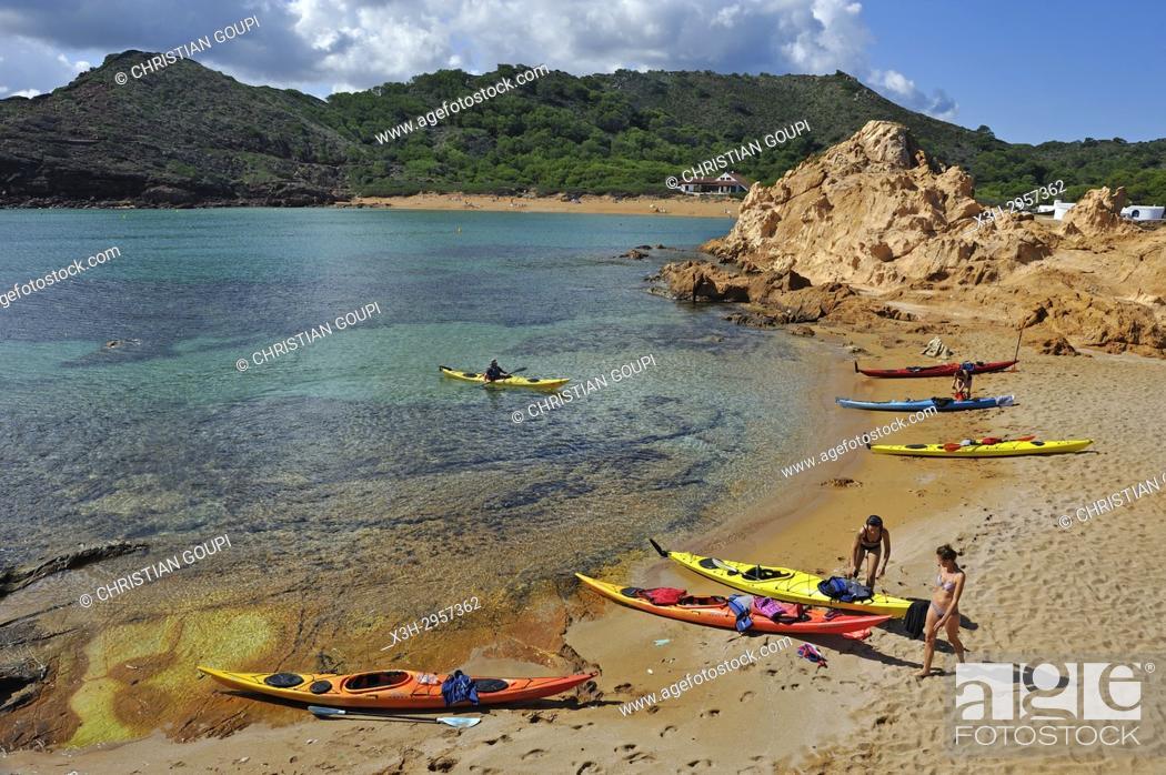 Stock Photo: kayaks landing on an islet in the inlet Cala Pregonda near Cape Cavalleria on the North Coast of Menorca, Balearic Islands, Spain, Europe.