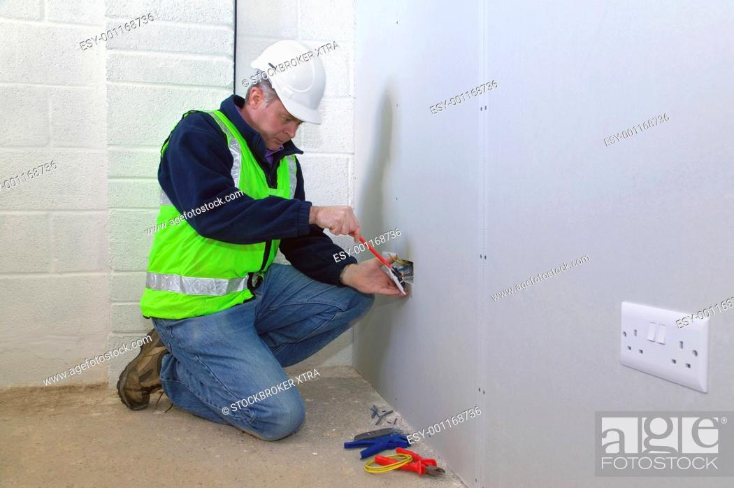 Stock Photo: Electrician at work.