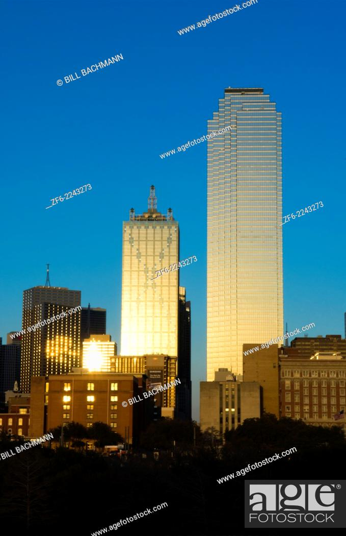 Stock Photo: Dallas Texas skyline at sunset of modern skyscrapers in downtown Dallas city across expressway.
