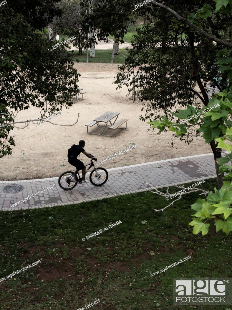 Stock Photo: Biker at the old river bed Turia, Valencia, Spain.