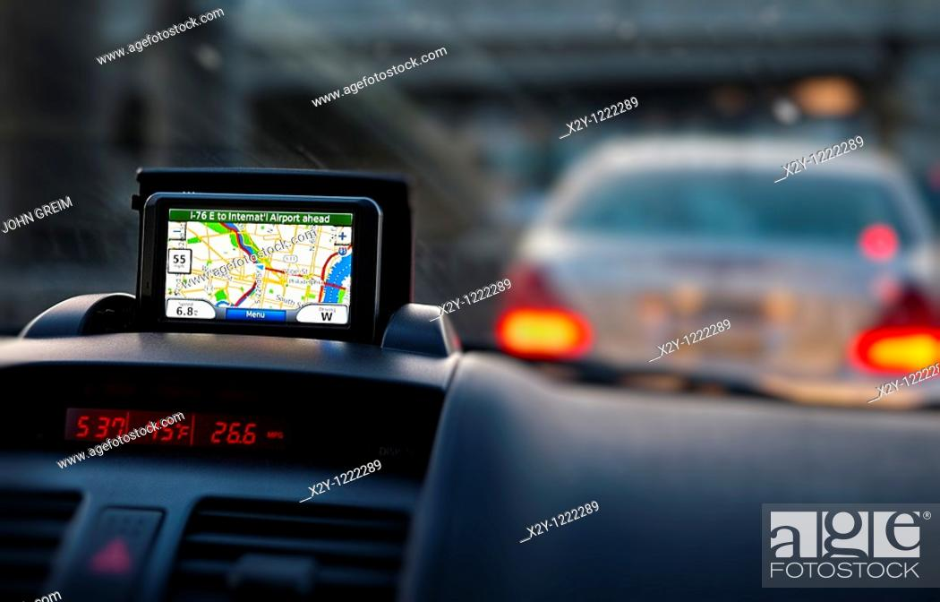 Stock Photo: GPS unit on the dashboard of a car.