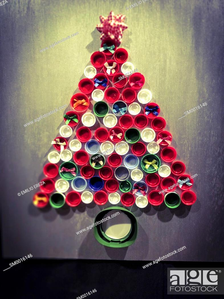 Stock Photo: Christmas tree made with plastic caps.