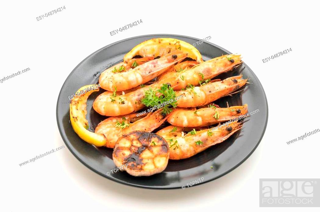 Stock Photo: fried shrimps with garlic and lemon isolated on white background.