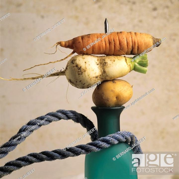 Stock Photo: Variety of vegetables, bottle, rope.