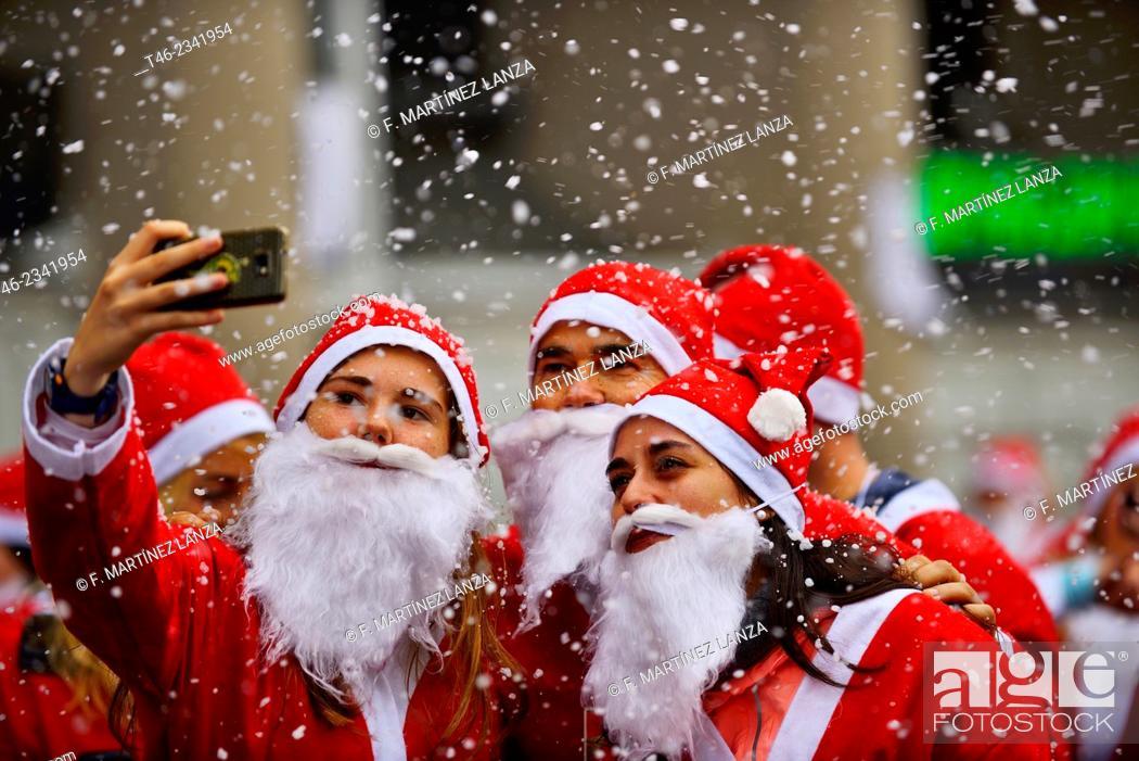Stock Photo: Santas doing a selfie during Santa Claus Race in Madrid, Spain.