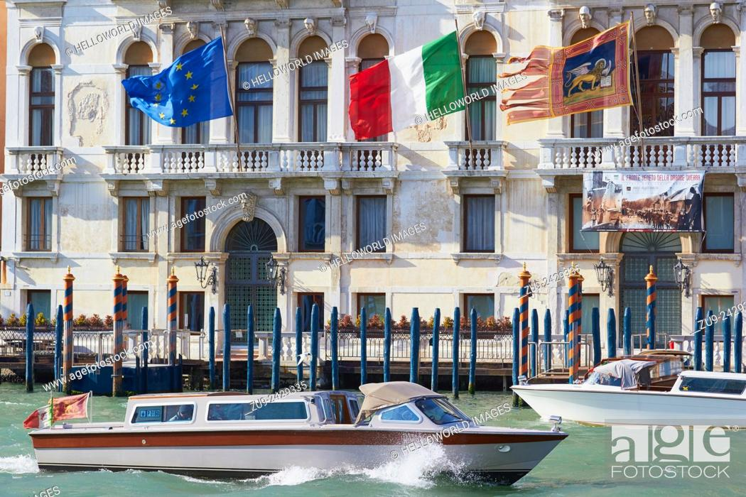 Imagen: Water taxis on the grand canal passing Palazzo Ferro Fini, Venice, Veneto, Italy, Europe.