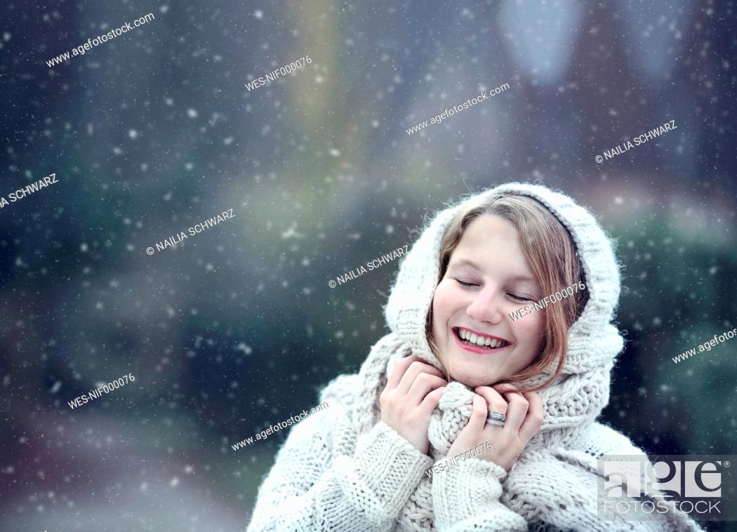 Stock Photo: Portrait of happy young woman wearing knitwear in winter.