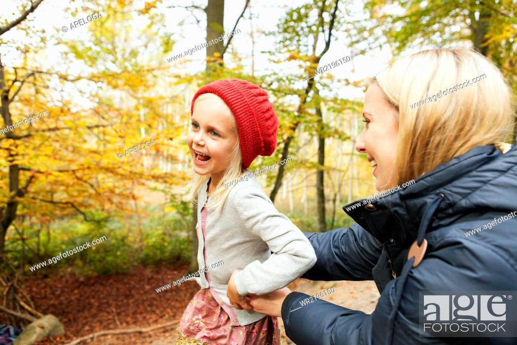 Stock Photo: Happy mother and daughter in forest.