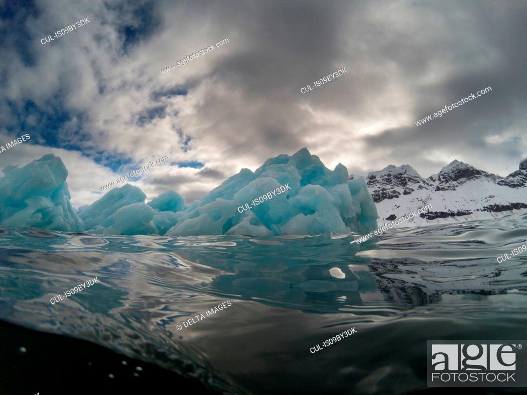 Stock Photo: Under and over view of arctic ocean and iceberg, Burgerbukta, Spitsbergen, Svalbard, Norway.