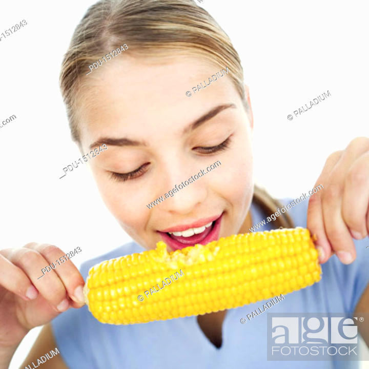 Stock Photo: Close-up of a teenage girl (15-17) eating a corncob.