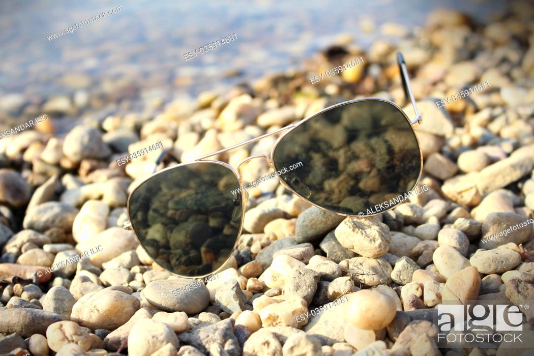 Stock Photo: Sunglasses resting on the beach.