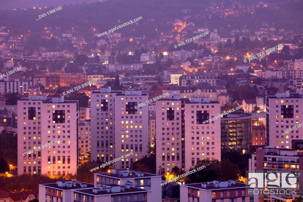 Stock Photo: France, Puy-de-Dome Department, Auvergne Region, Clermont-Ferrand, city overview from Parc de Monjuzet, dusk.