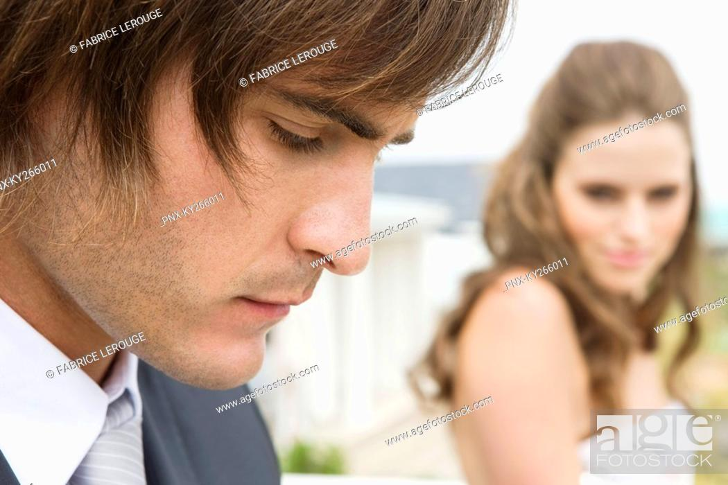 Stock Photo: Close-up of a groom beside a bride.