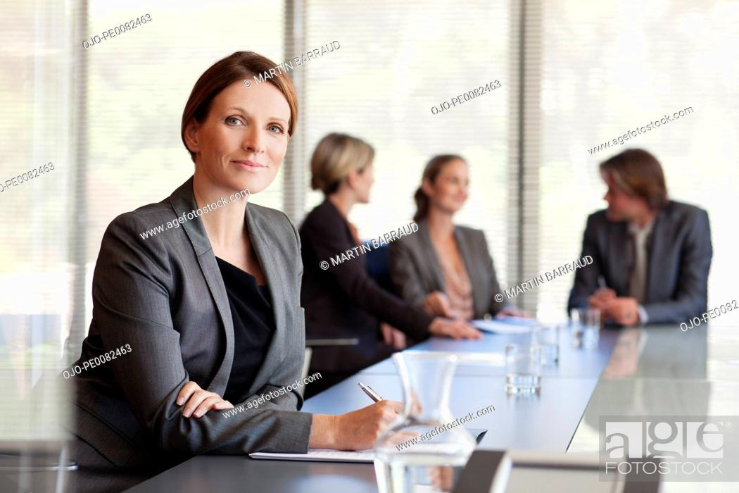 Stock Photo: Portrait of confident businesswoman in conference room.