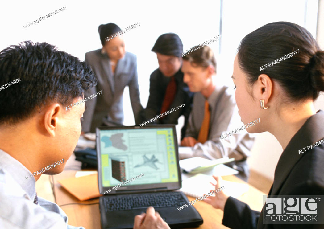 Stock Photo: Businesspeople working in office.