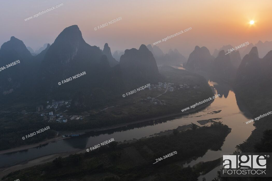 Stock Photo: Sunrise over Xingping karsts hills in Xianggong hill and Li river at sunset near Yangshuo in Guanxi province, China.