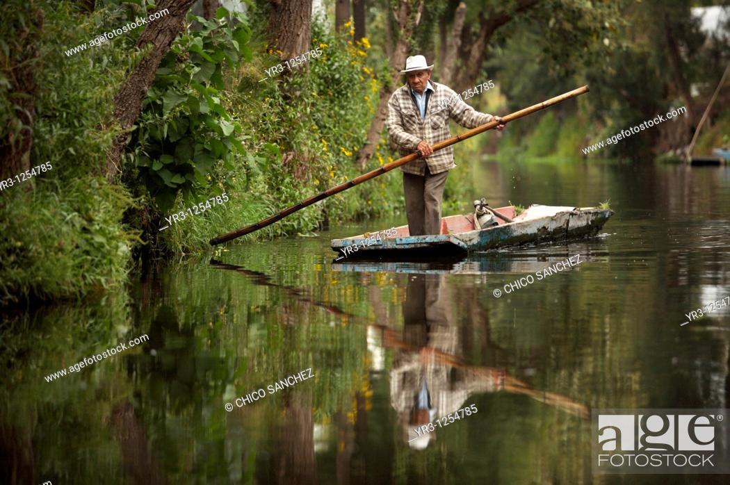 Stock Photo: A farmer navigates through the water canals of San Gregorio Atlapulco village in Xochimilco, southern Mexico City.