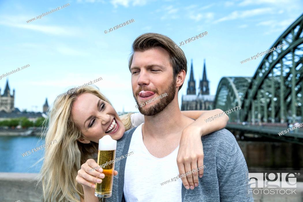 Stock Photo: Germany, Cologne, young man tasting Koelsch.