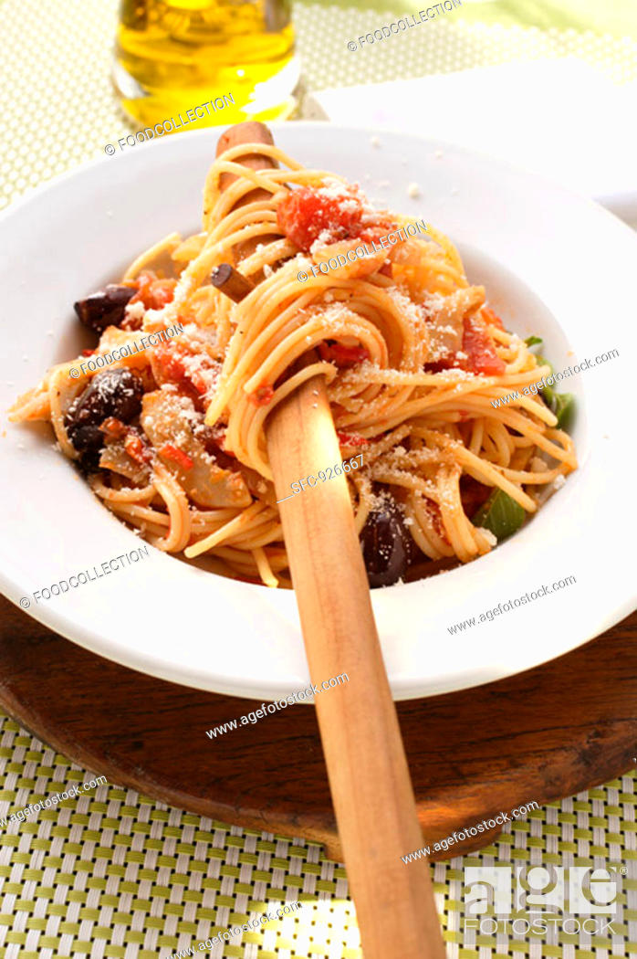 Stock Photo: Spaghetti with olives, tomatoes and Parmesan.