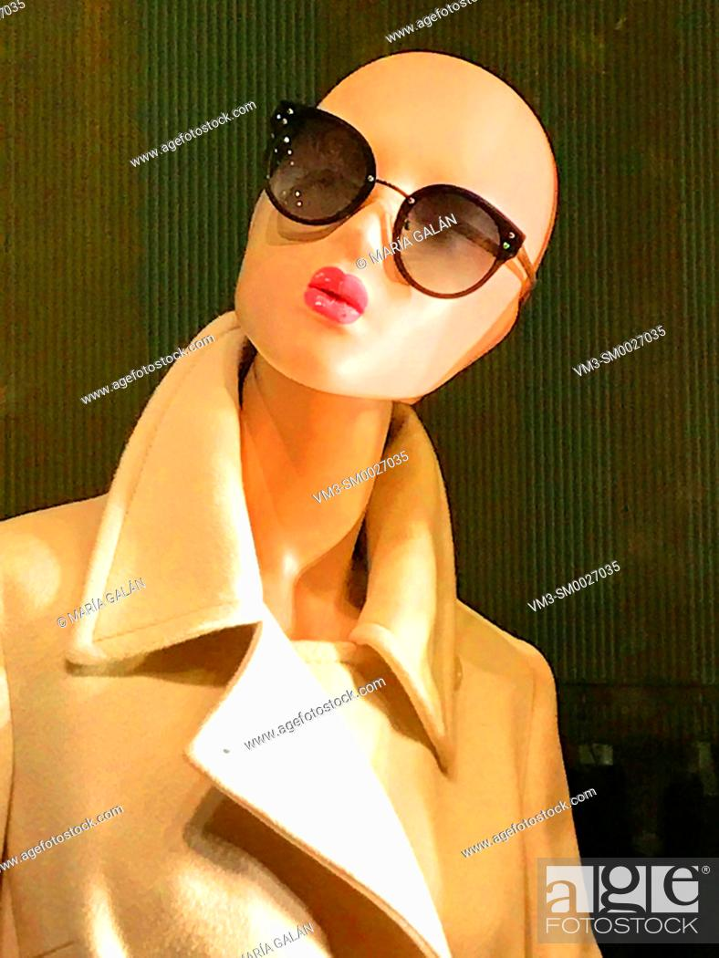 Stock Photo: Mannequin wearing coat and sunglasses.