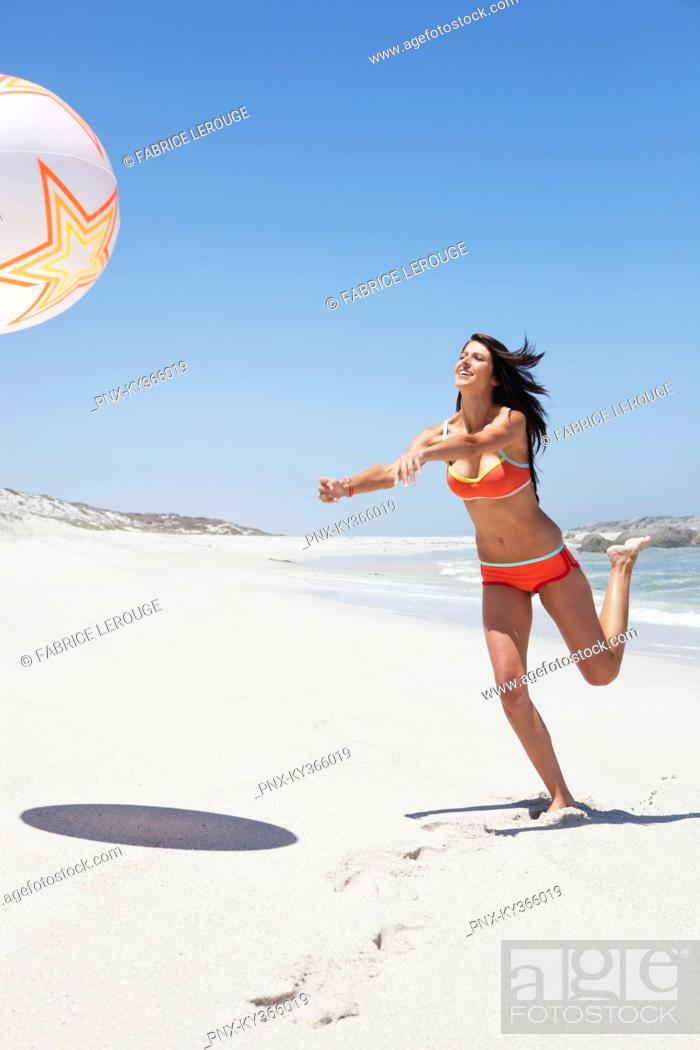 Stock Photo: Woman playing with beach ball.