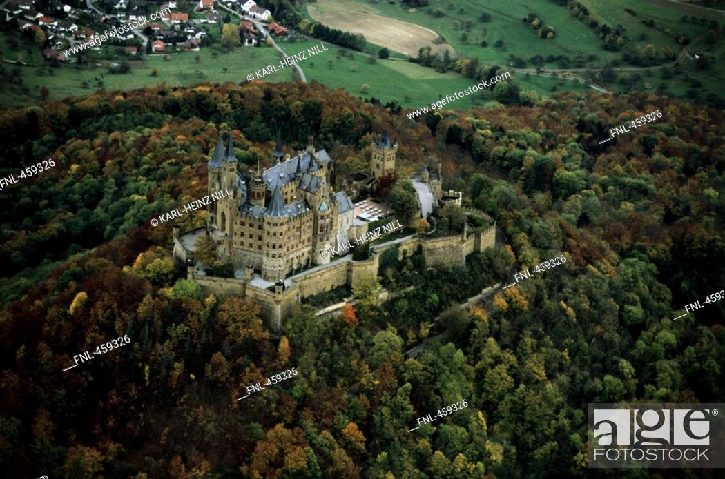 Stock Photo: Aerial view of castle surrounded by autumn trees, Hohenzollern Castle, Swabian Alb, Baden-Wurttemberg, Germany.