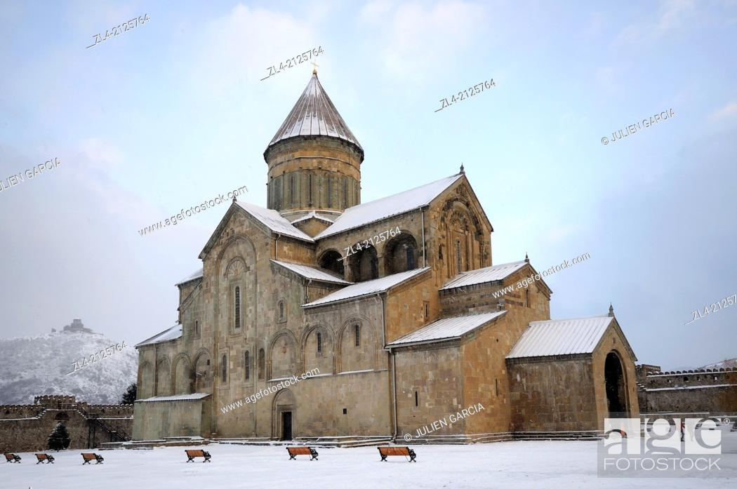 Stock Photo: The christian orthodox cathedral of Svetitskhoveli covered with snow and Jvari monastery far on the hill. Georgia, Caucasus, Kartli, Mtskheta (ancient capital).